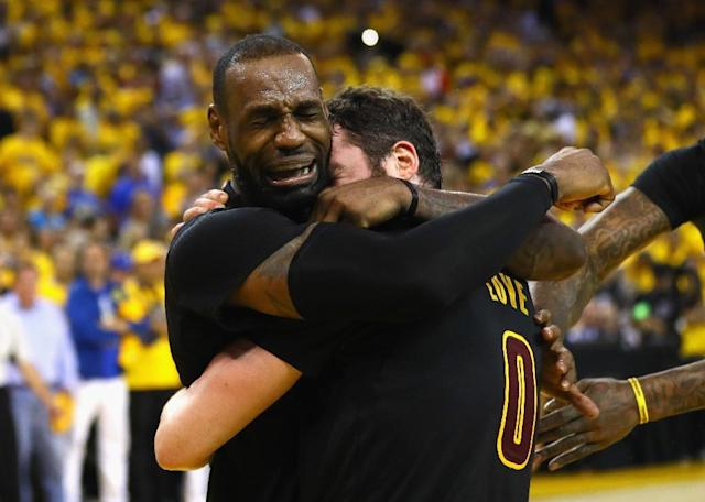 LeBron James (left) and Kevin Love of the Cleveland Cavaliers celebrate winning the decisive Game 7 of the NBA Finals in Oakland, California, on June 19, 2016 (AFP Photo/Ezra Shaw)