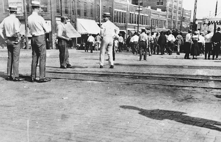 People stand in the street during the Tulsa race massacre.