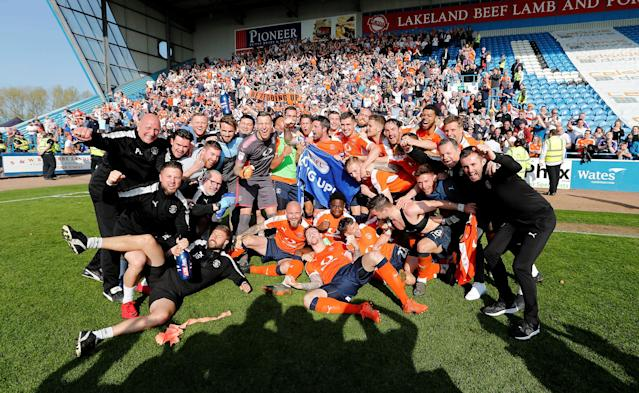 "Soccer Football - League Two - Carlisle United v Luton Town - Brunton Park, Carlisle, Britain - April 21, 2018 Luton Town celebrate promotion after the game Action Images/John Clifton EDITORIAL USE ONLY. No use with unauthorized audio, video, data, fixture lists, club/league logos or ""live"" services. Online in-match use limited to 75 images, no video emulation. No use in betting, games or single club/league/player publications. Please contact your account representative for further details."
