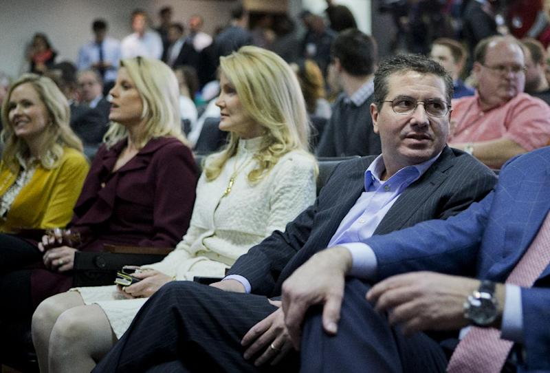 Washington Redskins owner Daniel Snyder, right, is seated with, from left to right, Sherry Gruden, wife of new head coach Jay Gruden; Kiersten Allen, wife of Executive Vice President and General Manager Bruce Allen; and his spouse Tanya Snyder, as they attend a news conference to introduce Jay Gruden as the new Redskins head coach at the Redskins Park in Ashburn, Va., Thursday, Jan. 9, 2014. Jay Gruden is Redskin's eighth head coach since Daniel Snyder purchased the franchise in 1999. (AP Photo/Manuel Balce Ceneta)