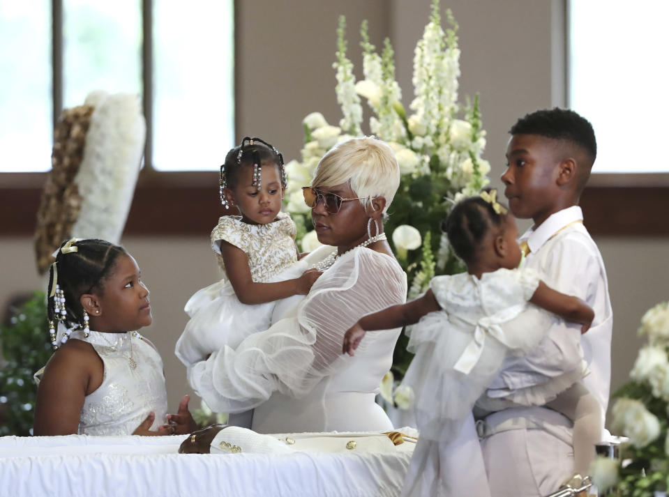 Tomika Miller, wife of Rayshard Brooks, with her children at his funeral service on Tuesday. (Curtis Compton/Atlanta Journal-Constitution via AP, Pool)
