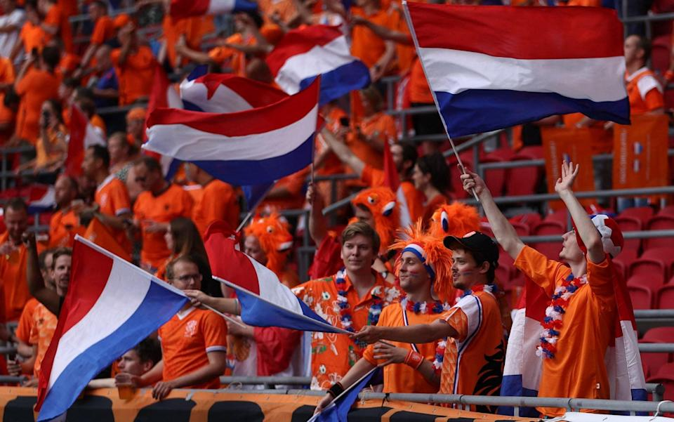 Dutch fans wave flags in the stands - AFP