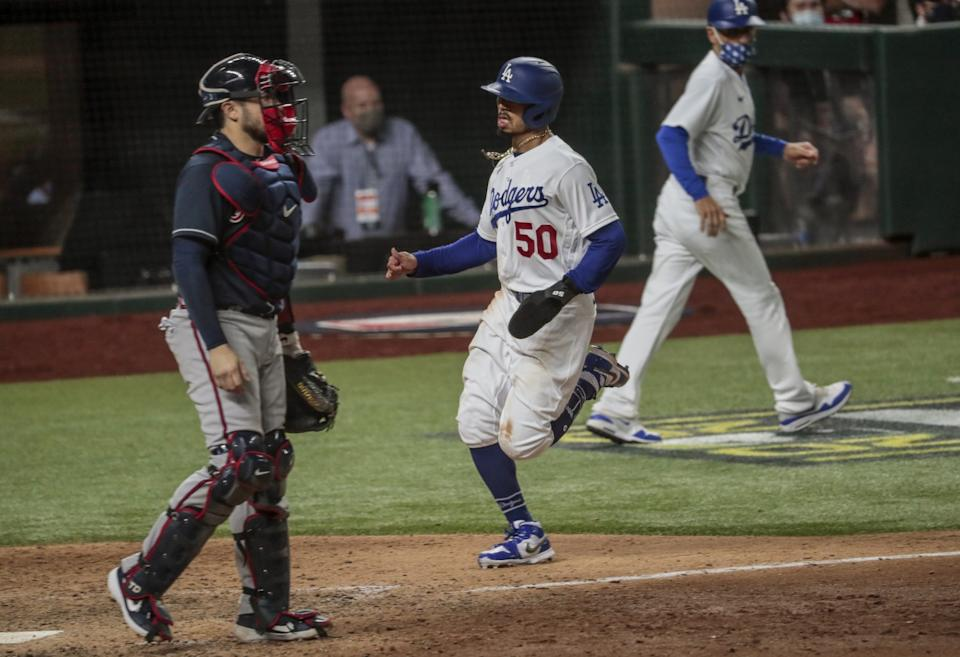 Dodgers right fielder Mookie Betts scores on a double by Corey Seager in the ninth inning.