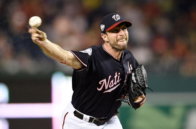 FILE - In this Sept. 25, 2018, file photo, Washington Nationals starting pitcher Max Scherzer delivers during the fourth inning of a baseball game against the Miami Marlins in Washington. If three-time Cy Young Award winner Scherzer has his way, Major League Baseball's pitch clock will die in the South Florida humidity. (AP Photo/Nick Wass, File)