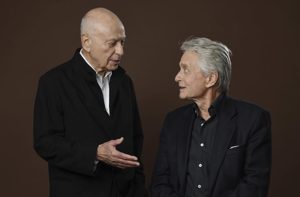 """In this Nov. 7, 2018 photo, Alan Arkin, left, and Michael Douglas, cast members in the Netflix comedy series """"The Kominsky Method,"""" appear at the Beverly Wilshire Four Seasons hotel in Beverly Hills, Calif. The pair play Hollywood veterans facing the indignities of aging in a change-of-pace comedy-drama from sitcom hitmaker Chuck Lorre. (Photo by Chris Pizzello/Invision/AP)"""
