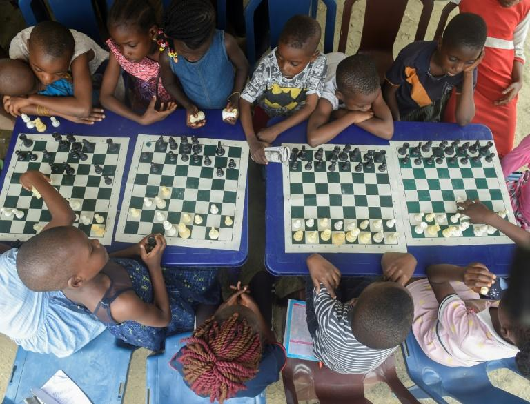 Children in a Lagos slum are being taught chess under a project aimed at bringing them hope and confidence (AFP Photo/PIUS UTOMI EKPEI)