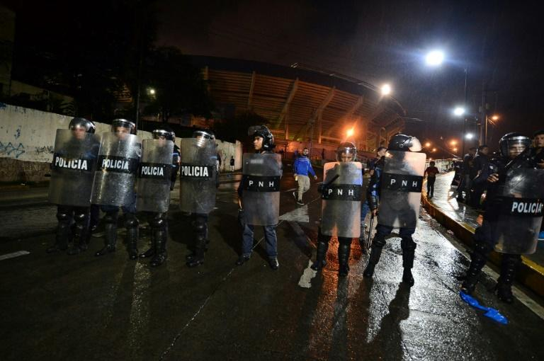 The riot is believed to have started when a bus carrying Motagua players was attacked (AFP Photo/ORLANDO SIERRA)