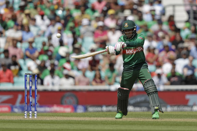 Bangladesh's Mushfiqur Rahim hits a shot that was caught out by South Africa's Rassie van der Dussen during the Cricket World Cup match between South Africa and Bangladesh at the Oval in London, Sunday, June 2, 2019. (AP Photo/Matt Dunham)