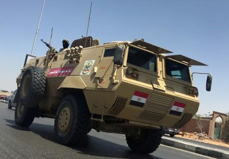Egyptian military vehicle patrols on highway outside cemetary in Cairo