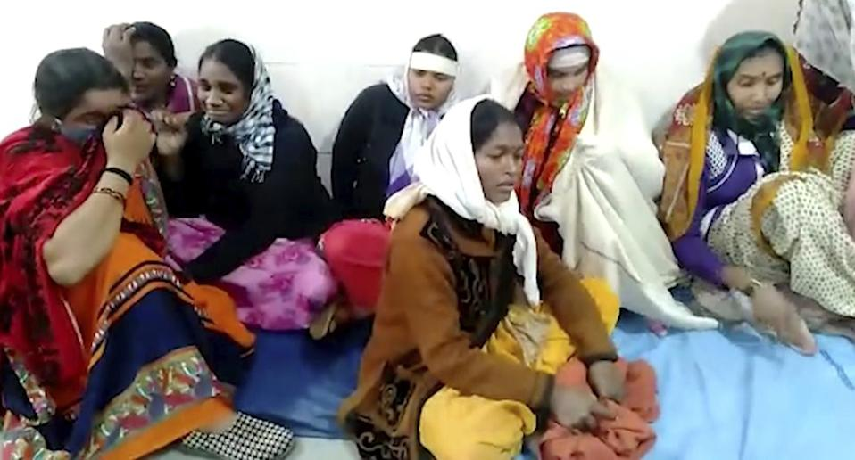 This frame grab from video provided by KK Productions shows women grieving at District General Hospital where a fire broke out in Bhandara, about 70 kilometres from Nagpur, India, Saturday, Jan. 9, 2021. A fire broke out in the intensive care unit of a government-run hospital in western India early Saturday, killing 10 infants, police and news reports said.