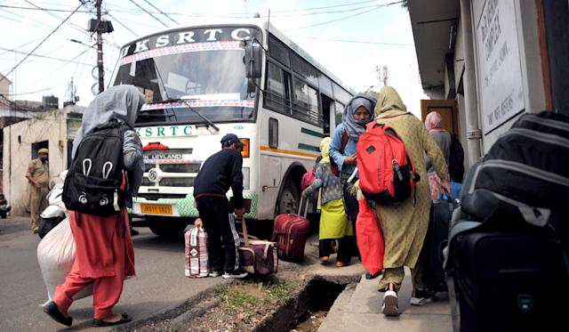 Students from Ladakh who were left stranded in the wake of COVID-19 lockdown, board a bus back home on May 11, 2020 in Jammu. (Photo by Nitin Kanotra/Hindustan Times via Getty Images)
