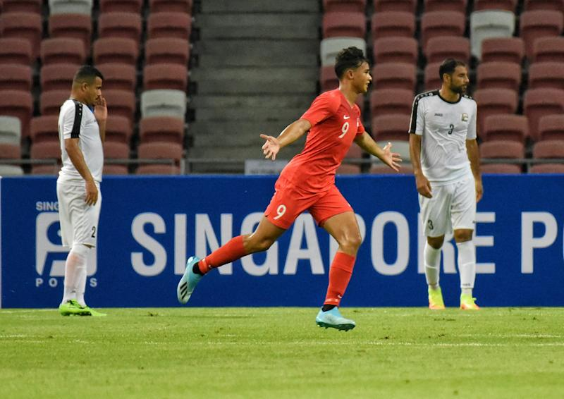 Singapore striker Ikhsan Fandi celebrates after scoring the first goal against Yemen in their 2022 World Cup qualifying match at the National Stadium. (PHOTO: Zainal Yahya/Yahoo News Singapore)