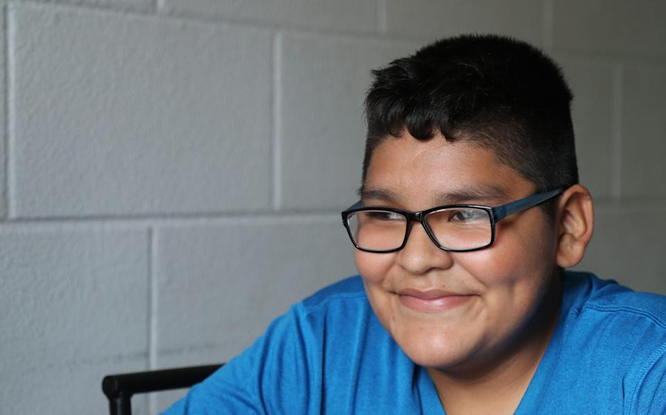Brandon Garcia, 13, found virtual school to be tough. His grades slipped and some days he climbed an apple tree to connect to school because the internet connection was better.