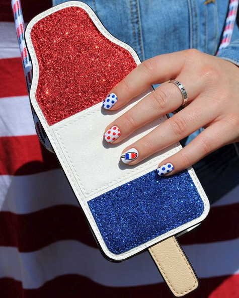 "<p>Make your manicure stand out by drawing on red and blue dots over a white polish, and add a nail sticker to the mix to make it even more fun!</p><p><a class=""link rapid-noclick-resp"" href=""https://www.amazon.com/ALLYDREW-Sheets-Stickers-Bikini-Popsicle/dp/B077F5LM3D/?tag=syn-yahoo-20&ascsubtag=%5Bartid%7C10055.g.1278%5Bsrc%7Cyahoo-us"" rel=""nofollow noopener"" target=""_blank"" data-ylk=""slk:SHOP NAIL DECALS"">SHOP NAIL DECALS</a></p>"