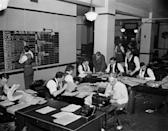 Journalists work on election night in Washington, D.C., Nov. 8, 1938. In background hunched over a writer is Milo Thompson, Washington chief of bureau, who directed the operation. (AP Photo)
