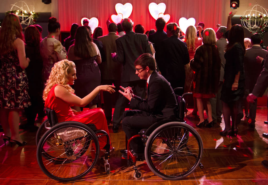 "Artie (Kevin McHale) dances with Emma's niece Betty (guest star Ali Stroker) in the ""I Do"" episode of ""Glee."""