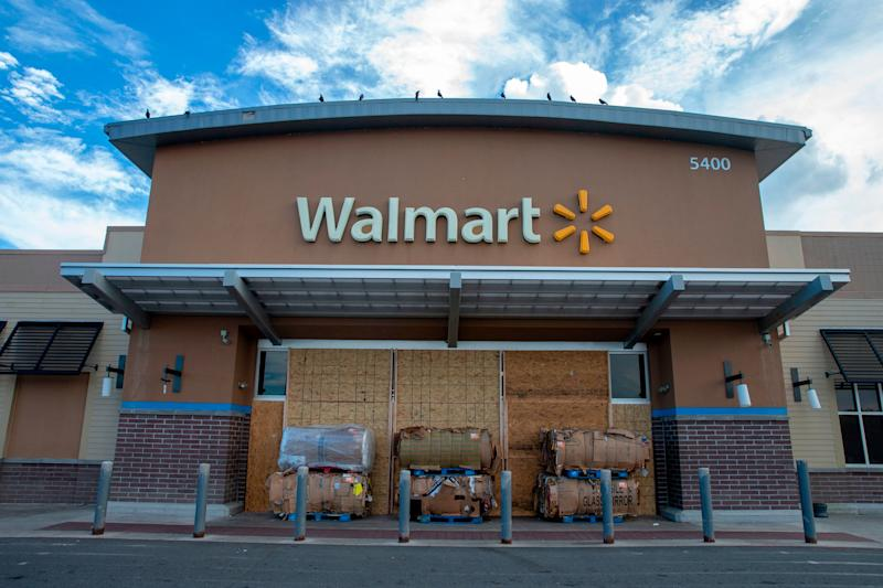 Wood boards and cardboard boxes block the entrance to a Walmart store in Kill Devil Hills in the Outer Banks of North Carolina on Tuesday.