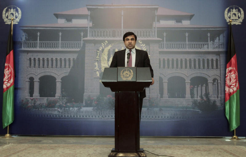 Foreign Ministry spokesman Janan Mosazai speaks during a press conference in Kabul, Afghanistan, Sunday, June 23, 2013. Mosazai said the Afghan government remains willing to send a peace delegation to Doha to negotiate with the Taliban once it has its explanation of how the Taliban were allowed to open an office in Qatar that was akin to an embassy, flying the militant group's flag and using its formal name from the years it ruled the country, as well as assurances that the office will be nothing more than a place for talks. (AP Photo/Rahmat Gul)