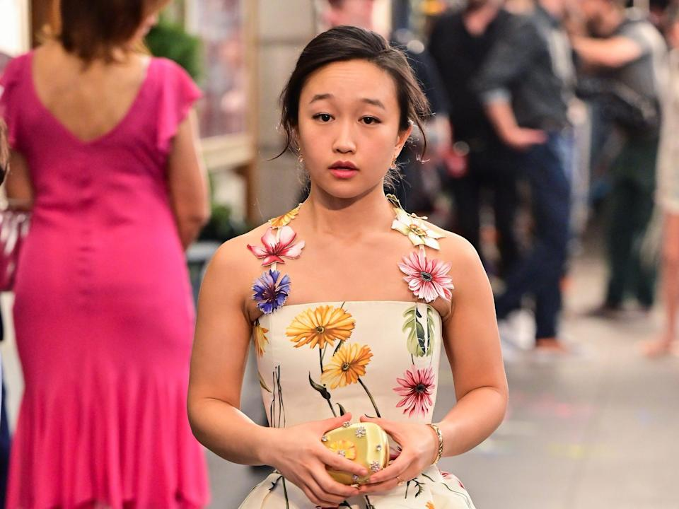 """Cathy Ang wears a floral dress on the set of """"And Just Like That..."""" in July 2021."""