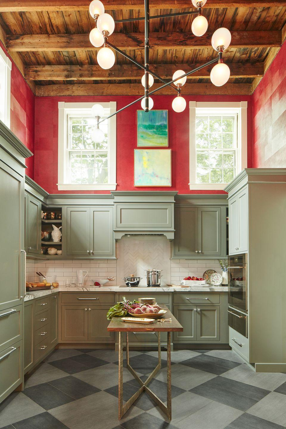"<p>This charming old-school kitchen by <a href=""https://vanisayeedstudios.com/"" rel=""nofollow noopener"" target=""_blank"" data-ylk=""slk:Vani Sayeed Studios"" class=""link rapid-noclick-resp"">Vani Sayeed Studios</a> is well-balanced with a stunning, modern chandelier that draws the eye all the way up the room's enviably high ceilings. Resting above the kitchen's preferred prep station, this fixture brightens up the area for the whole family to join in on making dinner or brunch. </p>"