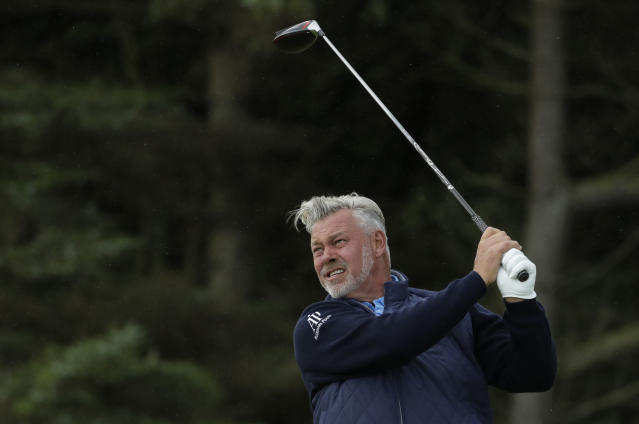 Northern Ireland's Darren Clarke hits his tee shot on the 5th hole during the first round of the British Open Golf Championships at Royal Portrush in Northern Ireland, Thursday, July 18, 2019.(AP Photo/Matt Dunham)