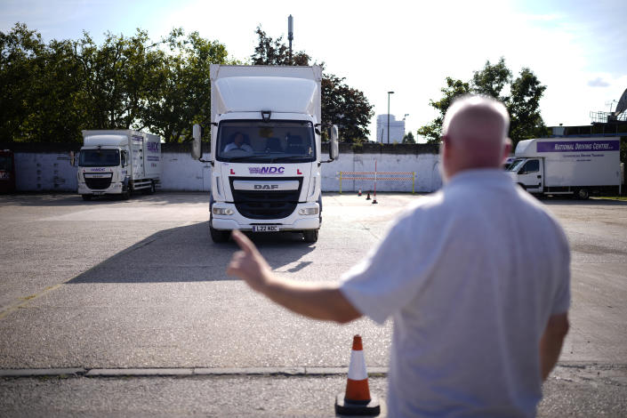 Instructor Graham Bolger directs learner truck driver Cadhene Lubin-Hewitt as he drives at the National Driving Centre in Croydon, south London, Wednesday, Sept. 22, 2021. Lubin-Hewitt, 32, moved to the UK when he was 16 from Trinidad and Tobago and has been driving buses and coaches for about 10 years. Britain doesn't have enough truck drivers. The shortage is contributing to scarcity of everything from McDonald's milkshakes to supermarket produce. (AP Photo/Matt Dunham)