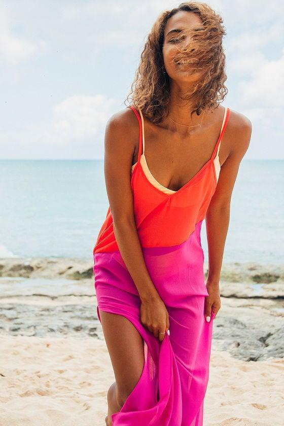 """<h2>Seaside Retreat Coral Red and Magenta Maxi Cover-Up</h2><br>Forget that beaten-up button-down or sack-like linen shift for a post-dip coverup — Lulus has blessed bathing beauties with a maximalist sheer frock that would definitely pass muster at the club (or the beach club). """"5-star coverup!"""" wrote reviewer Joanne B. """"The colors originally grabbed my attention, it was the fit and elegant flow of this dress that overwhelmed me! A perfect coverup for a resort in Los Cabos Mexico, too many compliments to count poolside."""" Customer Erica """"wore [the dress] to Coachella with a bodysuit underneath. it was pretty comfy and breathable. I will definitely be bringing this on future vacations!""""<br><br><strong>Lulus</strong> Seaside Retreat Coral Red and Magenta Maxi Cover-Up, $, available at <a href=""""https://go.skimresources.com/?id=30283X879131&url=https%3A%2F%2Fwww.lulus.com%2Fproducts%2Fseaside-retreat-coral-red-and-magenta-maxi-cover-up%2F621492.html"""" rel=""""nofollow noopener"""" target=""""_blank"""" data-ylk=""""slk:Lulus"""" class=""""link rapid-noclick-resp"""">Lulus</a>"""