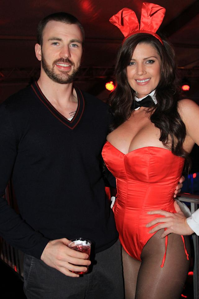Chris Evans poses with a Playmate at the Playboy Party at the Bud Light Hotel in Indianapolis.