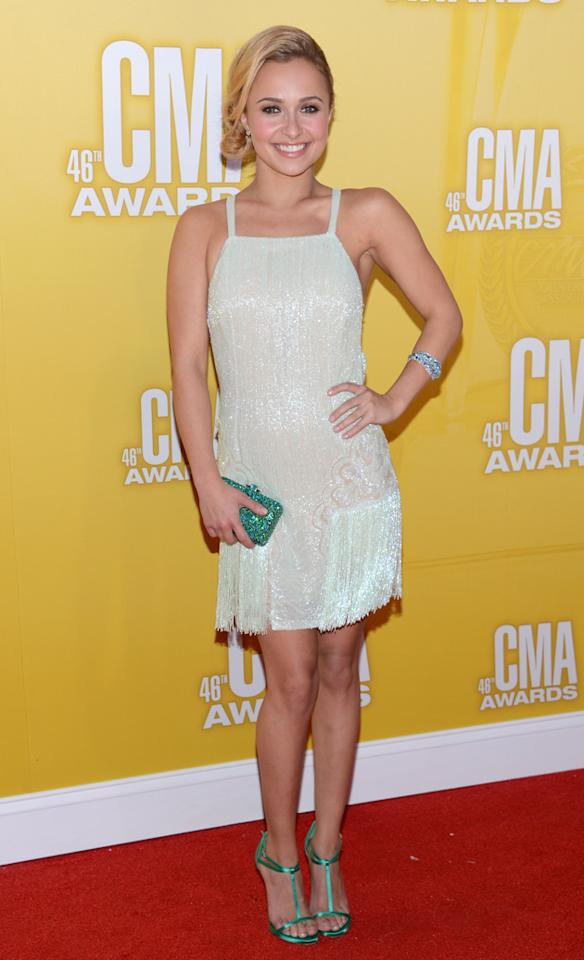 "What would an award show set in Nashville be without the star of ABC's ""Nashville""? Hayden Panettiere looked perky in a mint green fringed mini, which she paired with emerald-colored heels and a clutch. The actress and her co-star Connie Britton, who play rival country stars on the drama, were on hand at the CMAs to present an award. Before the show, Panettiere tweeted that she was ""so excited!!!"" (11/1/2012)"