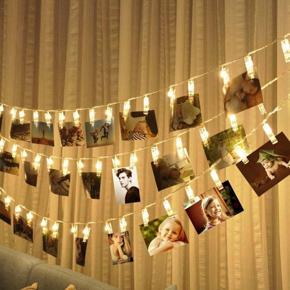 <p>Help them show off some photos they've taken with this string of <span>LED Photo Clip Lights</span> ($18), which holds 50 photos.</p>