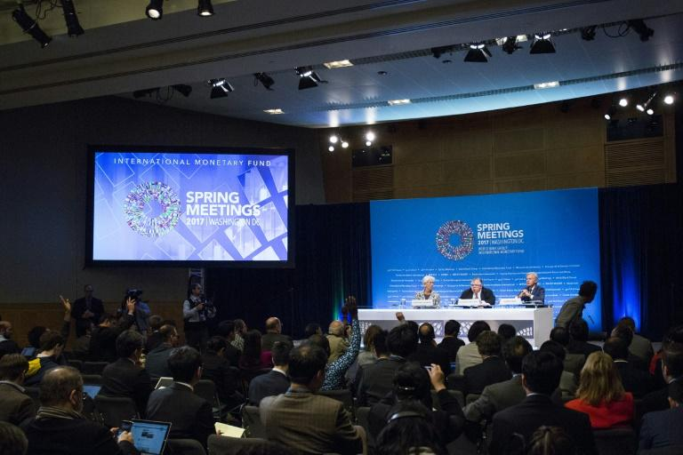 (L-R)IMF Managing Director Christine Lagarde, Chairman of the IMFC and Bank of Mexico Governor Agustin Carstens,  and IMF Communications Director Gerry Rice are pictured during at the World Bank IMF Spring Meetings April 22, 2017 in Washington, DC