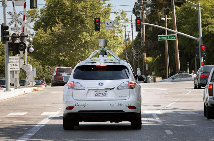 This Wednesday, April 23, 2014 photo provided by Google shows the Google driverless car navigating along a street in Mountain View, Calif. The director of Google's self-driving car project wrote in a blog post Monday, April 28, that development of the technology has entered a new stage: trying to master driving on city streets. Many times more complex than freeways, which the cars can now reliably navigate, city streets represent a huge challenge. (AP Photo/Google)