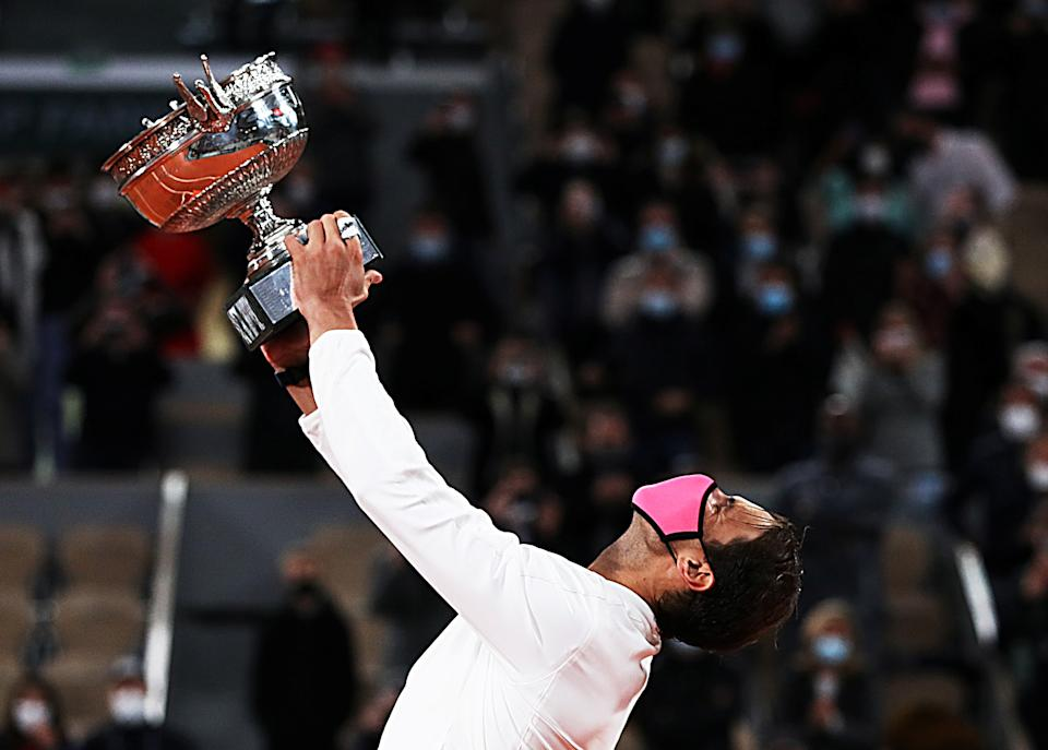FILE PHOTO: Rafael Nadal of Spain celebrates with the trophy during the awarding ceremony after winning the men's singles final match against Novak Djokovic of Serbia at the French Open tennis tournament 2020 at Roland Garros in Paris, France, Oct. 11, 2020. (Photo: Xinhua/Gao Jing via Getty Images)