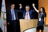 (From left) Mayor of Paris Anne Hidalgo, International Olympic Committee President Thomas Bach and Los Angeles Mayor Eric Garcetti pose on July 11, 2017 in Lausanne (AFP Photo/Fabrice COFFRINI)