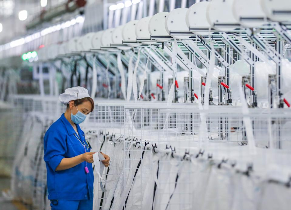JINJIANG, CHINA - MARCH 23 2020: A woman works in a factory of zippers in Jinjiang city in southeast China's Fujian province Monday, March 23, 2020.- PHOTOGRAPH BY Feature China / Barcroft Studios / Future Publishing (Photo credit should read Feature China/Barcroft Media via Getty Images)