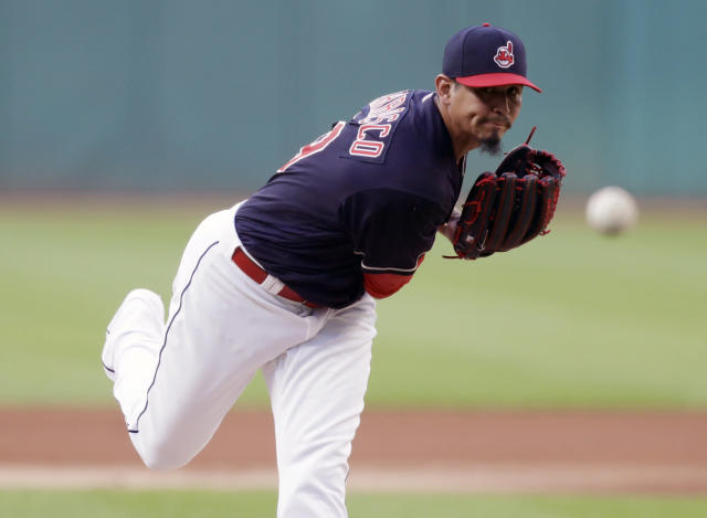 Cleveland Indians starting pitcher Carlos Carrasco delivers in the first inning of a baseball game against the Minnesota Twins, Tuesday, Aug. 28, 2018, in Cleveland. (AP Photo/Tony Dejak)