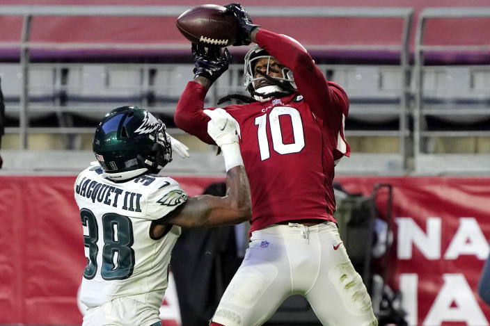 Arizona Cardinals wide receiver DeAndre Hopkins (10) scores a touchdown as Philadelphia Eagles defensive back Michael Jacquet (38) defends during the second half of an NFL football game, Sunday, Dec. 20, 2020, in Glendale, Ariz. (AP Photo/Rick Scuteri)