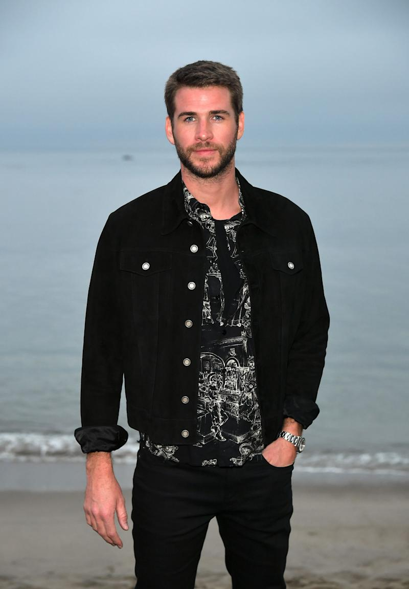 Liam Hemsworth dazzles in a casual black jacket and denim pant to match