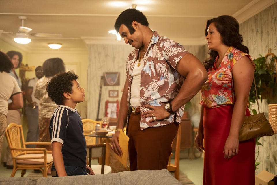 Adrian Groulx as young Dwayne Johnson, Joseph Lee Anderson as his father, Rocky Johnson, and Stacey Leilua as his mother Ata Johnson in 'Young rock' (Photo by: Mark Taylor/NBC)