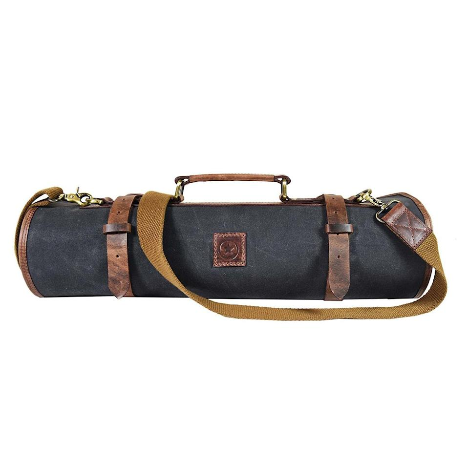 """<p><strong>AARON LEATHER GOODS</strong></p><p>amazon.com</p><p><strong>$59.99</strong></p><p><a href=""""https://www.amazon.com/dp/B07CXT5RWY?tag=syn-yahoo-20&ascsubtag=%5Bartid%7C10055.g.29535920%5Bsrc%7Cyahoo-us"""" rel=""""nofollow noopener"""" target=""""_blank"""" data-ylk=""""slk:Shop Now"""" class=""""link rapid-noclick-resp"""">Shop Now</a></p><p>With a rating of 4.8 out of 5 stars on Amazon, this is the ultimate chef's knife roll-up bag with stretchy pockets that can store up to 10 knives and other kitchen tools.</p>"""