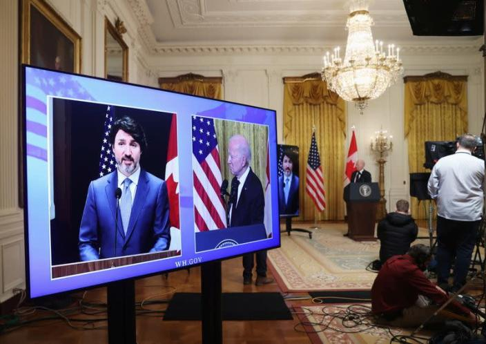 U.S. President Joe Biden and Canada's Prime Minister Justin Trudeau, appearing via video conference call, give closing remarks at the end of their virtual bilateral meeting from the White House in Washington