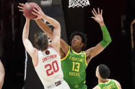 Utah forward Mikael Jantunen (20) shoots as Oregon forward Chandler Lawson (13) defends during the first half of an NCAA college basketball game Saturday, Jan. 9, 2021, in Salt Lake City. (AP Photo/Rick Bowmer)