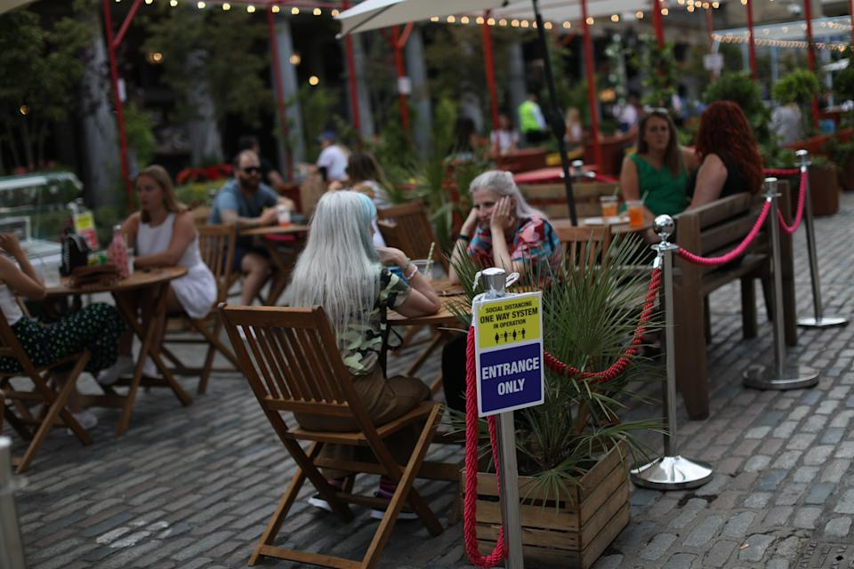 People enjoy a meal out in Covent Garden, London. The �Eat Out to Help Out' scheme will give diners a half-price discount on meals during the whole month of August, as the Government aims at boosting restaurant and pub trade following the lockdown. Picture date: Friday August 7, 2020.