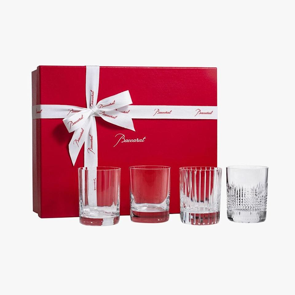 """Half the joy of ordering a cocktail at the Baccarat Hotel is the glassware. Will it be a goblet the color of a ruby? An etched Champagne coupe? An elegant tumbler? Recreate the experience at home with this set of four crystal glasses used by the hotel's showmen bartenders. $490, BACCARAT. <a href=""""https://us.baccarat.com/en/bar-on-the-rocks/highballs-tumblers-and-shot-glasses/4-elements-set-2812728.html"""" rel=""""nofollow noopener"""" target=""""_blank"""" data-ylk=""""slk:Get it now!"""" class=""""link rapid-noclick-resp"""">Get it now!</a>"""