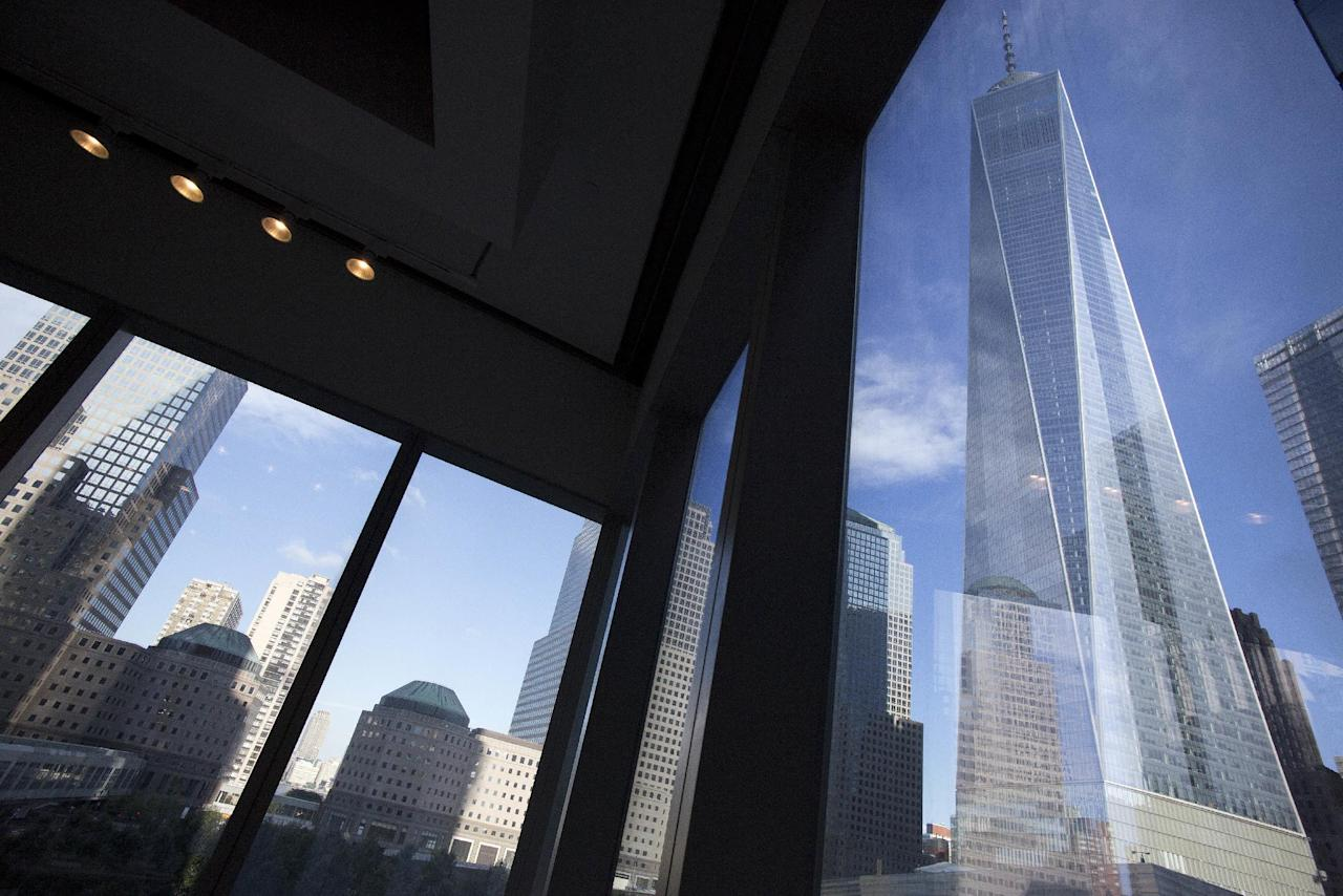 FILE - In this Aug. 15, 2016 file photo, Window seating in Eataly offers a view of One World Trade Center, right, in New York. Fifteen years after the Sept. 11th attacks, downtown New York has been reborn, not just with the construction of One World Trade, but with a host of attractions both somber and vibrant, including the 9/11 Memorial and Museum, two retail malls, new hotels and restaurants. (AP Photo/Mark Lennihan, File)