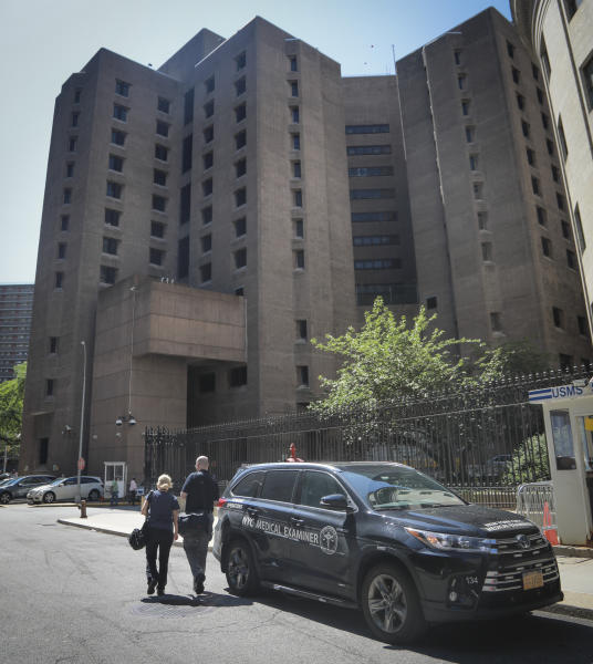 New York City medical examiner personnel leave their vehicle and walk to the Manhattan Correctional Center where financier Jeffrey Epstein died by suicide while awaiting trial on sex-trafficking charges, Saturday Aug. 10, 2019, in New York. Epstein was found in his cell at the facility Saturday morning, according to the officials, who was briefed on the matter but spoke on condition of anonymity because he wasn't authorized to discuss it publicly. The medical examiner's office in Manhattan confirmed Epstein's death. (AP Photo/Bebeto Matthews)