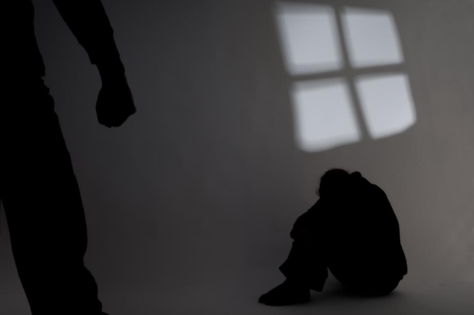Victim of abuse cowering in corner. (PHOTO: Getty Images)
