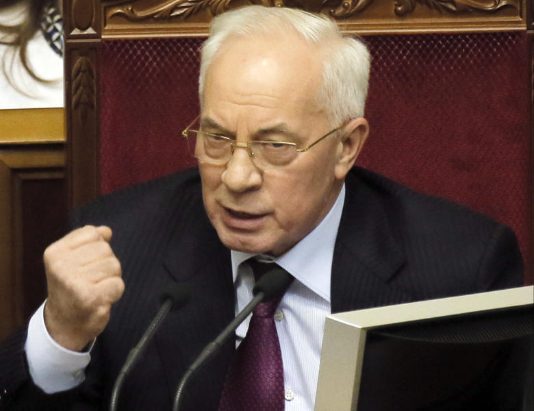 """FILE - In this Tuesday, Dec. 3, 2013 file photo, Ukraine's Prime Minister Mykola Azarov speaks to lawmakers during the parliament session in Kiev, Ukraine, Tuesday, Jan. 29, 2014. Azarov offered his resignation in order to encourage what he called """"social-political compromise.""""(AP Photo/Efrem Lukatsky, File )"""