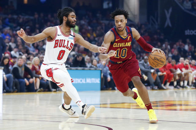 Cleveland Cavaliers' Darius Garland (10) drives on Chicago Bulls' Coby White (0) in the first half of an NBA basketball game, Saturday, Jan. 25, 2020, in Cleveland. (AP Photo/Ron Schwane)