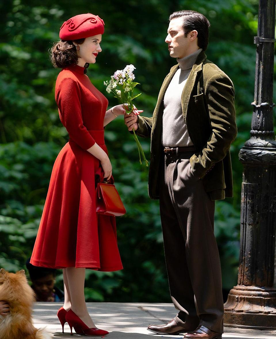 <p>While we don't know the exact details of Ventimiglia's character, it certainly <em>looks</em> like things are about to get little romantic! In one photo, the actor hands Brosnahan a bouquet of flowers. </p>